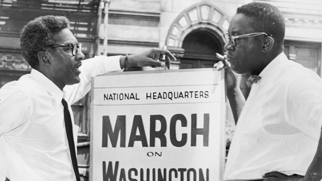 Bayard Rustin In front of 170 W 130 St., March on Washington, Bayard Rustin, Deputy Director, and Cleveland Robinson, Chairman of Administrative Committee (left to right). World Telegram & Sun photo by O. Fernandez. (Library of Congress's Prints and Photographs division)